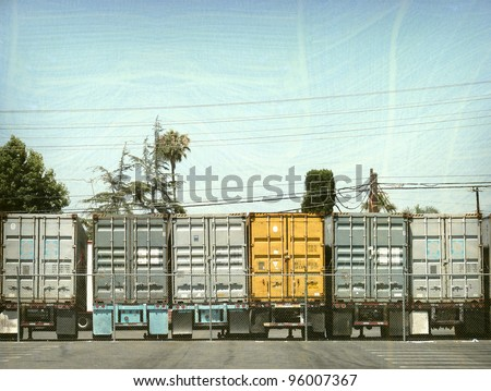 aged and worn vintage photo of 18 wheeler truck trailers lined up - stock photo