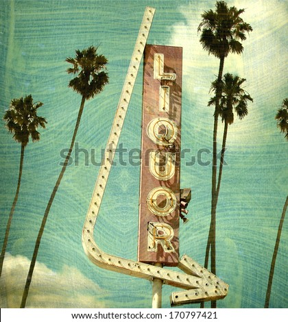 agerd and worn vintage photo of liquor store neon sign with palm trees                            - stock photo