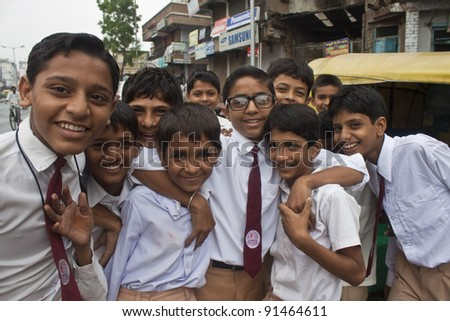 AHMEDABAD, INDIA - SEPTEMBER 7: Unidentified children in school uniforms at September 7, 2011 in Ahmedabad, India. Education has been made free for children for 6 to 14 years of age in India.