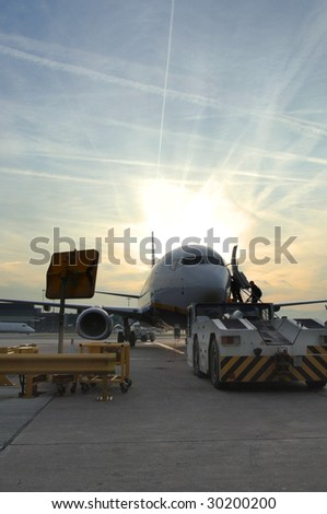 737 Aircraft boarding passengers - stock photo