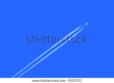 Airplane in the sky with  jet trail - stock photo
