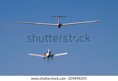 airplane towing a glider - stock photo