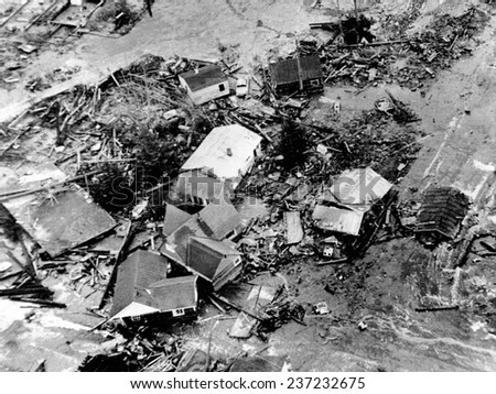 1964 Alaska Earthquake A 30 foot high tidal wave caused by the 9.2 earthquake destroyed low lying areas of coastal town of Seward. - stock photo