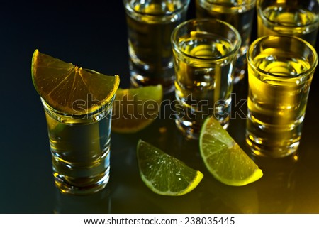 alcoholic drink with lime on a glass table