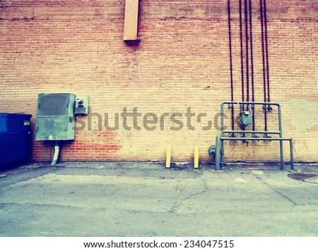 alleyway building and walls toned with a retro vintage instagram filter  - stock photo