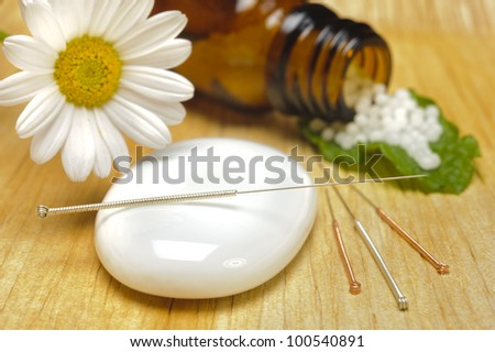 alternative medicine with homeopathy, globules and acupuncture - stock photo