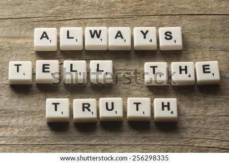 """Always Tell The Truth"" text on a wooden background - stock photo"