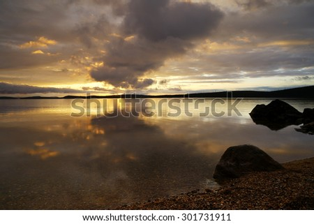 amazing sunset on the lake    - stock photo