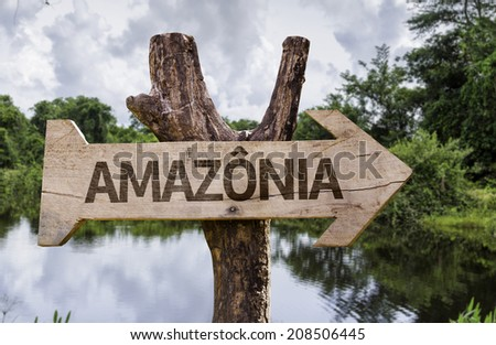 """Amazonia"" (In portuguese - Amazon Rainforest) wooden sign on a forest background - stock photo"