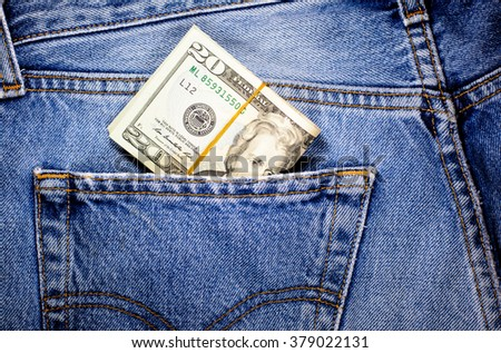 20 American dollar currency,money in jeans pocket ready for travel and shopping - stock photo