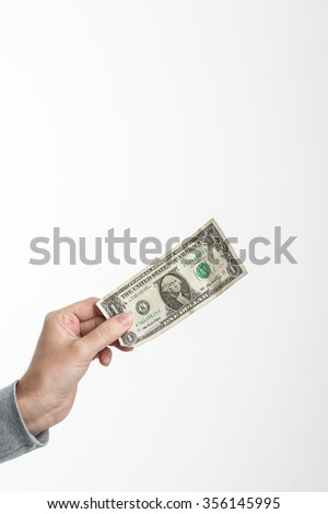 1 american dollar in the hand