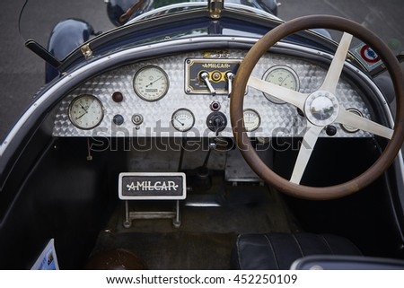 1926 Amilcar dashboard and steering wheel at a vintage cars rally -36th Tour de Bretagne - of the ABVA in Ploneour-Lanvern, Brittany, France. 05/15/2016