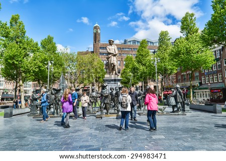 AMSTERDAM - MAY 28, 2015: Monument Rembrandt on a sunny day. Dutch artist, painter and engraver, the great master of chiaroscuro, the largest representative of the golden age of Dutch painting - stock photo