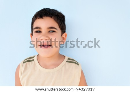Amusing portrait of a toothless boy - stock photo