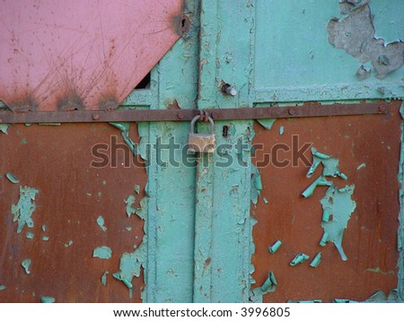 an ancient rusty hinged door - stock photo