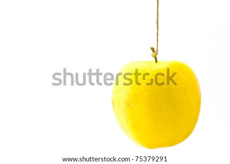 ,an apple hung to the thread. Abstract metaphor, - stock photo