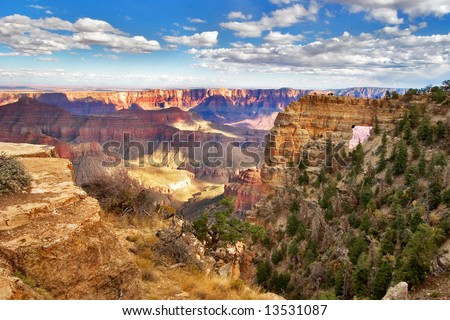An arch in a ledge of the Grand Canyon in the USA - stock photo