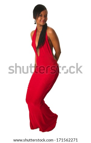 An attractive black African lady is dancing away in her red dress. - stock photo