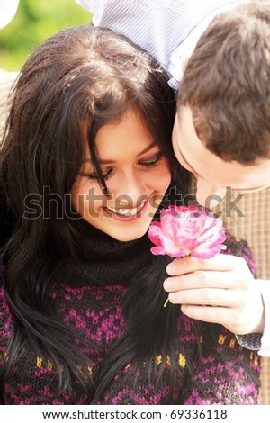 An attractive couple caught in a moment - stock photo