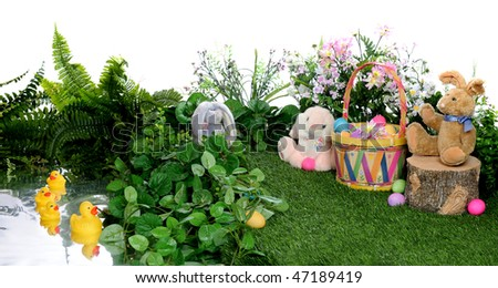 An Easter basket, bunnies, ducks and colored egg among spring foliage and a pond.  Isolated on white.