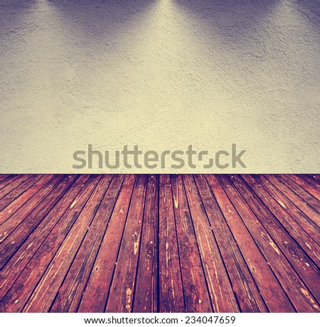 an image of an empty room with gray tones and a brown wood floor toned with a retro vintage instagram filter  - stock photo