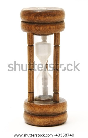 an old wooden hourglass on white background - stock photo