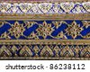 ancient ceramic tiles on the wall of wat phra kaew, bangkok, thailand - stock photo