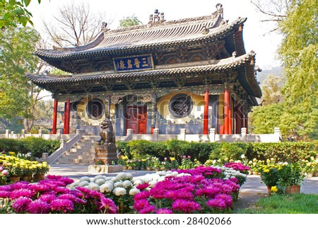 Ancient Chinese temple  and flowers - stock photo