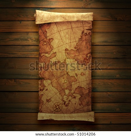 ancient scroll map, on a wooden background - stock photo