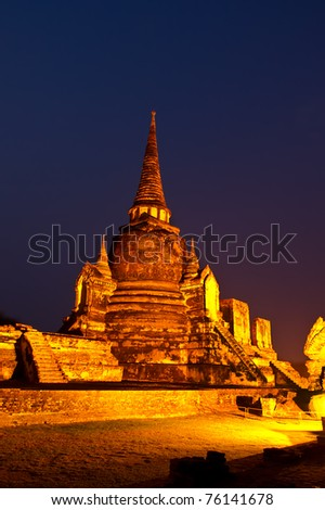 ancient temple in Thailand at night - stock photo