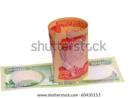 10000 and 25000 dinar of iraq - stock photo