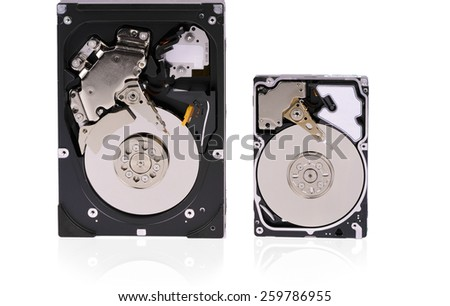 "3,5"" and 2,5"" hard disk drives opened on a white background - stock photo"