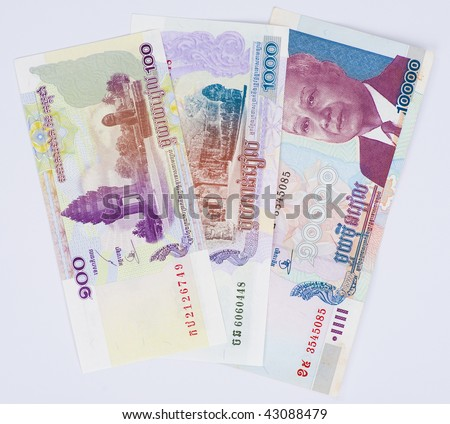 100, 1000 and 10000 riel banknotes from cambodia - stock photo