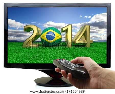 2014 and soccer ball with Brazil flag on tv - stock photo