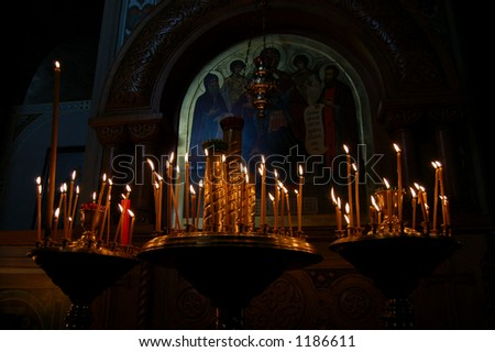 ?andles lighted in the church - stock photo