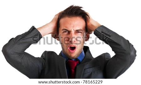 Angry businessman with hands in his hair isolated on white - stock photo