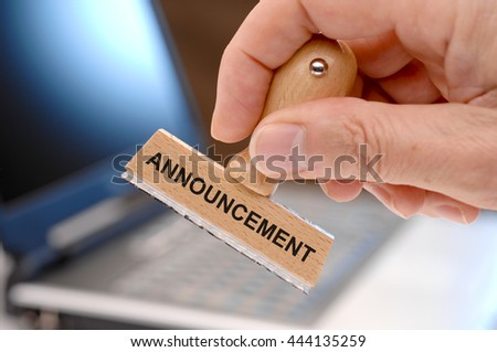 announcement printed on rubber stamp - stock photo