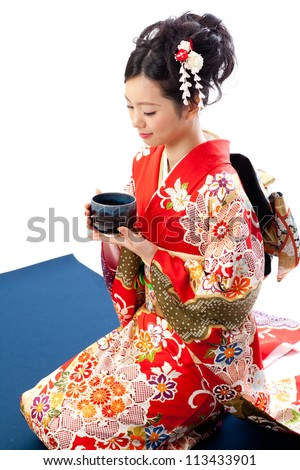 ?apanese kimono woman drinking japanese tea on white background - stock photo