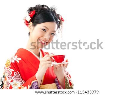 ?apanese kimono woman drinking tea on white background - stock photo