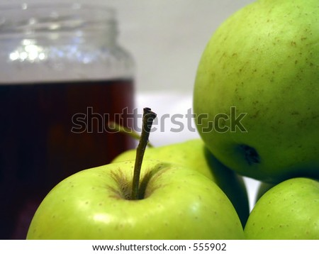 Apples and honey, traditional symbolic food for Rosh Hashana, the Jewish new years day 	 - stock photo