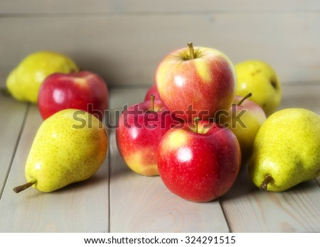 Apples and pears on a wooden background - stock photo