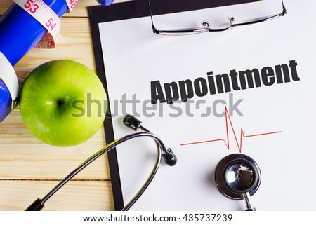 """""""Appointment"""" text on paper with heart beat diagram, stethoscope, delicious green apple, measurement tape and blue dumbbell on wooden table - medical, health and disease concept - stock photo"""
