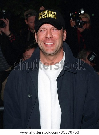 """01APR98:  Actor BRUCE WILLIS at the premiere of his new movie, """"Mercury Rising,"""" at the Academy Theatre in Beverly Hills. - stock photo"""