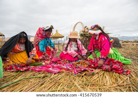 22 APR 2015 : Woman selling agricultural porduct on Floating Uros island, Lake Titicaca, Peru