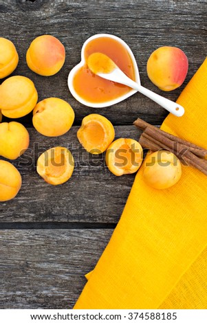 Apricot jam on rustic wooden background - stock photo