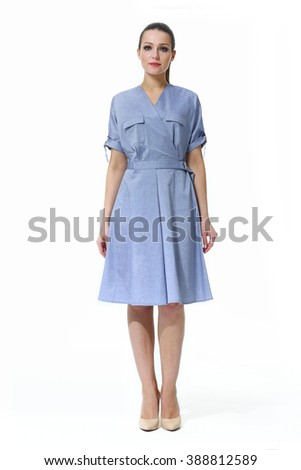 arabian asian eastern brunette business executive woman with straight hair style in light blue belt summer short sleeves dress high heel shoes standing full body length isolated on white - stock photo