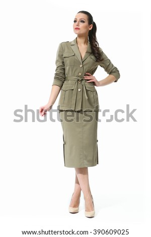 arabian asian eastern brunette business executive woman with straight hair style in printed ethnic safari style suit high heel shoes standing full body length isolated on white - stock photo
