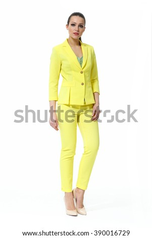 arabian asian eastern brunette business executive woman with straight hair style in yellow trousers jacket summer suit high heels shoes standing full body length isolated on white - stock photo