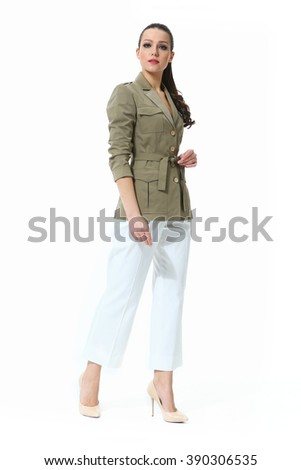 arabian asian eastern brunette business executive woman with straight ponytail hair style in safari jacket and white jeans high heel shoes standing full body length isolated on white - stock photo