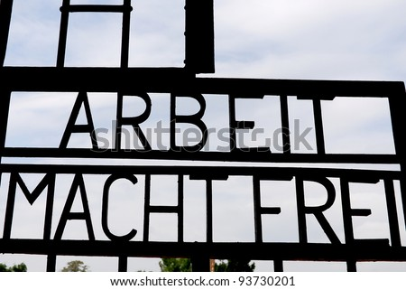 """Arbeit macht frei"" is a German phrase, literally ""work makes (one) free,"" meaning ""work sets you free"" or ""work liberates"". At the entrance of Sachsenhausen-Oranienburg was a Nazi concentration camp - stock photo"